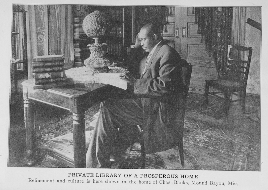 Black and white photo of Charles Banks in his home.