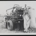 Black and white photo of a model cotton picker in 1937.